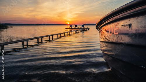 Foto auf AluDibond Pier Sunrise landscape with rescue boat and wooden pier.