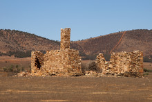 Hawker South Australia, Remains Of A Derelict Homestead With Bare Hills In Background