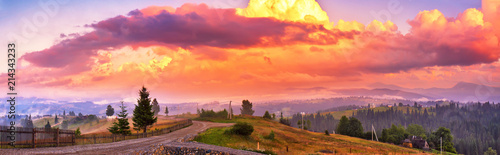 Poster Crimson Summer colorful sunset in mountains. Panorama of beautiful evening