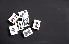 Pile Of Mahjong On Black Table