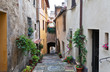 Italy. Tuscany. Traditional Italian narrow cozy streets with flowers in the medieval town of Montepulciano