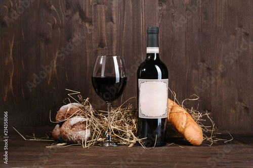 In de dag Bar red wine composition with bread bottle and wineglass on wooden background