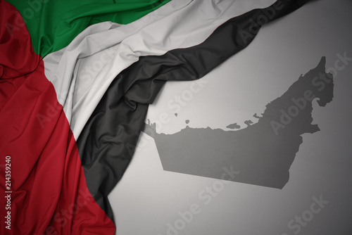 Fotografie, Obraz  waving colorful national flag and map of united arab emirates.