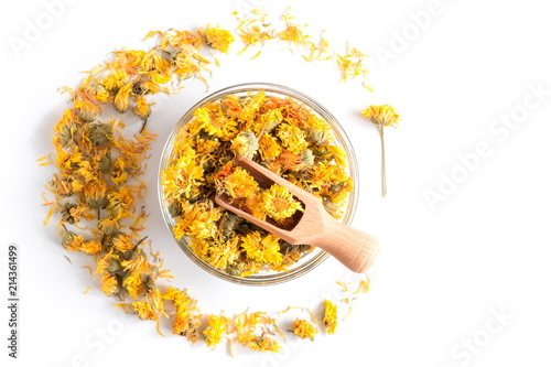Dried calendula flowers in glass round bowl isolated on white background Wallpaper Mural