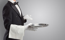 Waiter Serving With White Gloves And Steel Tray In An Empty Space