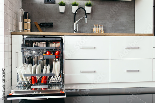 Fotografie, Tablou Modern open dishwasher with clean dishes in the white kitchen.