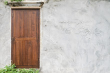 Closed Wooden Door In Concrete Wall With Copy Space - Outside View