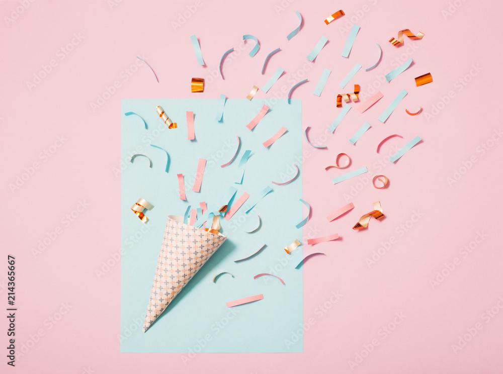 Fototapeta birthday hat with confetti on paper background - obraz na płótnie
