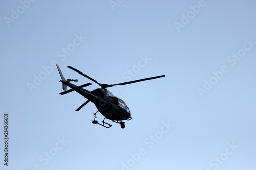Tuinposter Helicopter helicopter silhouette in flight