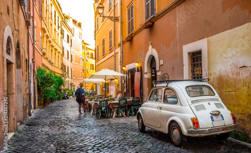 Photo Stands Rome Cozy street in Trastevere, Rome, Europe. Trastevere is a romantic district of Rome, along the Tiber in Rome. Turistic attraction of Rome.