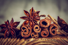 Cinnamon And Starry Anise On A Wooden Background