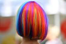 A Rainbow Colored Hairstyle Of A Woman Who Visits The Lesbian And Gay Street Party In Berlin-Germany.