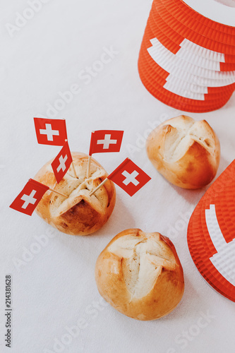 Traditional swiss bread buns called in German 1.Augustweggen baked in Switzerland to celebrate Swiss National Day on August 1st. The top of the bread being cut crosswise to shape a cross.