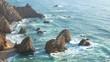 Waves ocean cliffs rocks