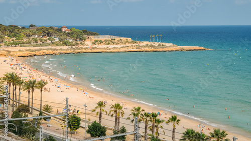 Poster Cote Sunbathers at Miracle Beach in Tarragona, Spain