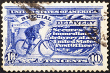 Postman Cycling On Very Old American Postage Stamp