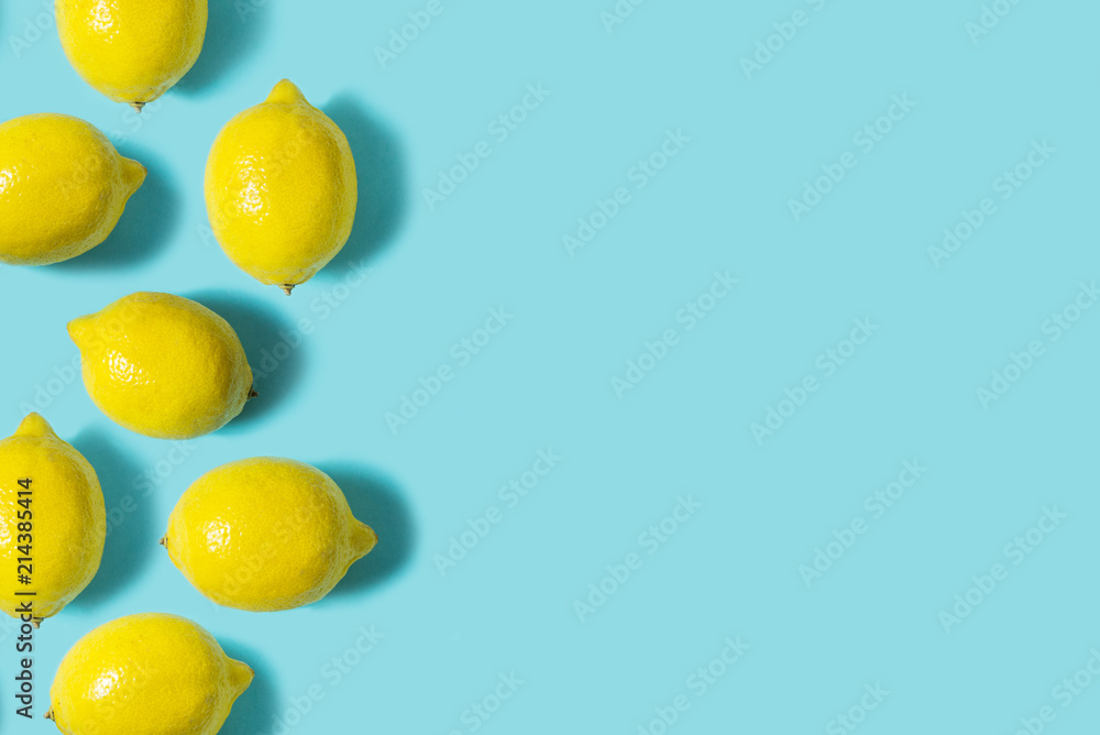 Fototapety, obrazy: Top view of fresh lemon isolated on blue background. Fruit minimal concept. Flat lay.