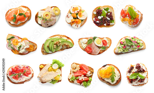Set with different delicious bruschettas on white background