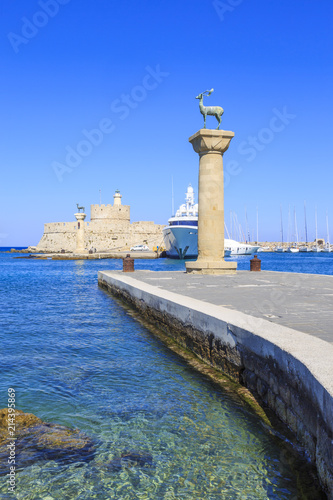Fotografie, Obraz  Mandarki harbor entrance of Rhodes, Dodecanese, Greece