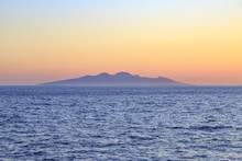 Entire Symi Island View From Distance During Sunset In Aegean Sea Near Symi, Dodecanese, Greece