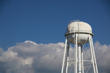 Water Tower With Clouds