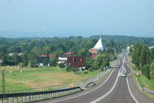 Fotobehang Olijf Straight road with green landscape, Poland