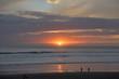 canvas print picture - Spiegelung im Wasser am Sandstrand in Muriwai Beach