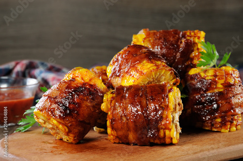 Fényképezés  Grilled corn wrapped in bacon