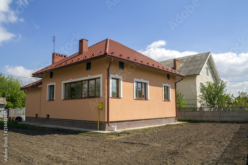 New Built One Cottage House With Red Tiling Roof Plastic Windows Plastered