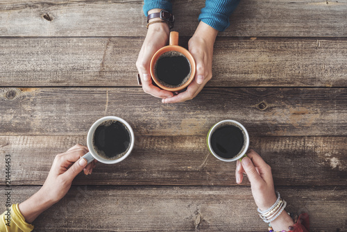People hands holding a cup of coffee