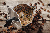 Fototapeta Coffie - Moka coffee pot and coffee beans on wooden background