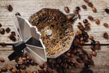 Fototapeta Kawa jest smaczna - Moka coffee pot and coffee beans on wooden background