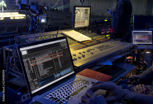 Photo music, technology, people and equipment concept - hands using mixing console in