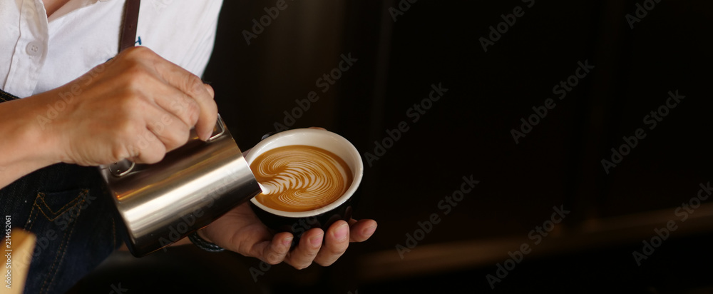 Fototapeta Branner of barista hand making a cup of coffee.