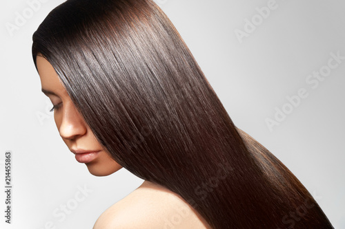 Obraz na plátně Beautiful young woman with clean skin, beautiful straight shiny hair, fashion makeup