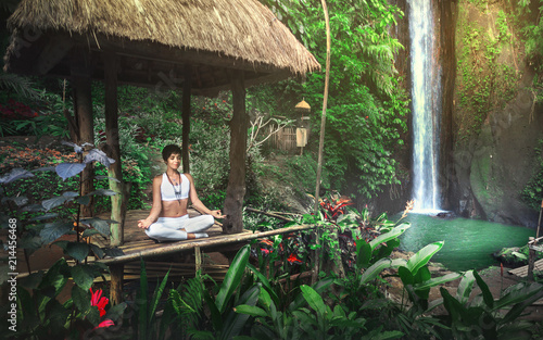 Poster de jardin Bali Serenity and yoga practicing at waterfall,Bali,Imdonesia