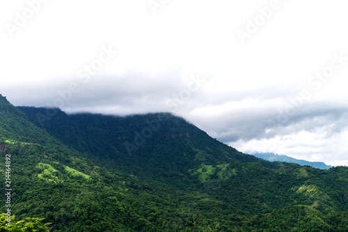 Fotobehang Wit Peak mountain cover by cloud in mist in a scenic landscape view