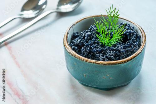 Black lumpfish caviar in a small pot