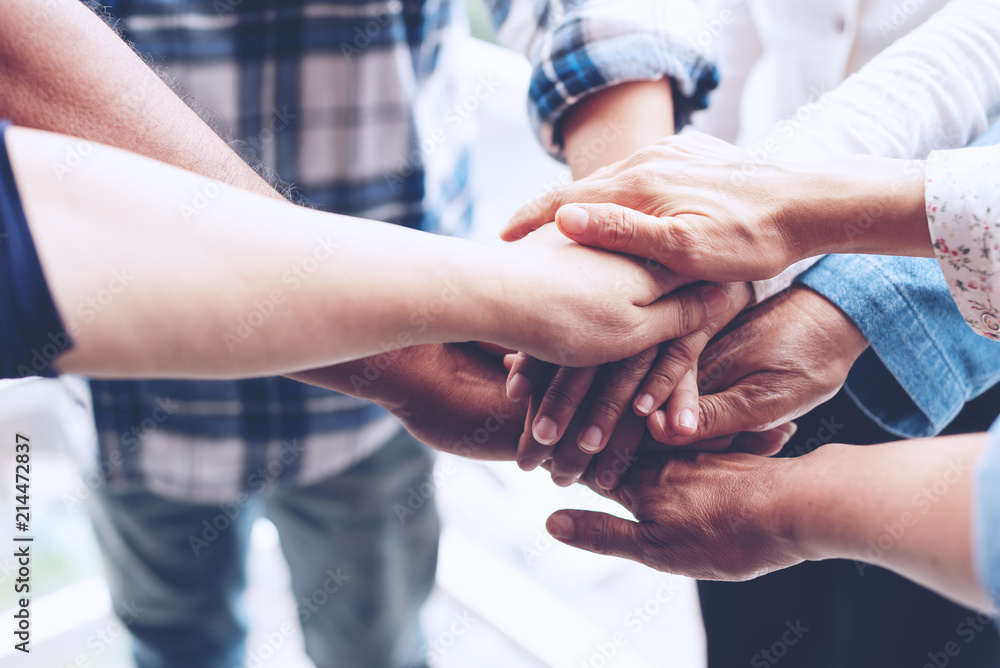 Fototapeta People hand assemble as a connection meeting teamwork concept. Group of people colleague assembly hands as a business or work achievement. Man and women touch each other hands. Teamwork conceptual.