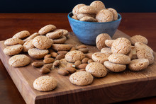 Amaretti Biscuits On A Wooden Board With Almonds