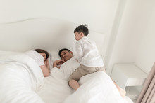 Boy Going To Annoy Wake Up Her Parents In Bed.
