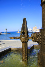 Fountain In Mandraki Port With...