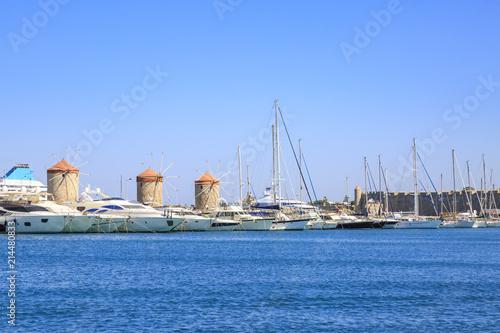 Fotografie, Obraz  Windmills in mandraki port in Rhodes, Dodecanese, Greece