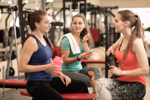 Deurstickers Fitness Happy women resting after workout in fitness gym