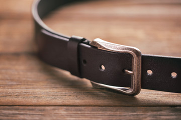 Leather belt on a wooden table