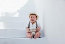 Beautiful Baby Sitting On Whit...