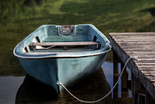 Old Rowing Boat Moored At A Scottish Highland Loch