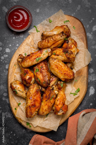 Fotobehang Grill / Barbecue Grilled chicken wings with ketchup and mustard sauces on wooden board. Traditional baked bbq buffalo