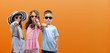 canvas print picture - Group of boy and girls kids over orange background pointing with finger to the camera and to you, hand sign, positive and confident gesture from the front