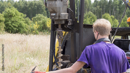Obraz Geotechnical investigation. Operator during work - geotechnical drilling rig - fototapety do salonu